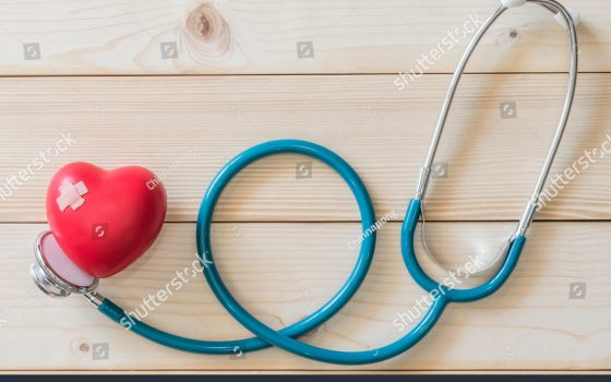 stock-photo-world-health-day-campaign-with-red-love-heart-with-cross-bandage-band-aid-and-medical-doctor-s-571724308
